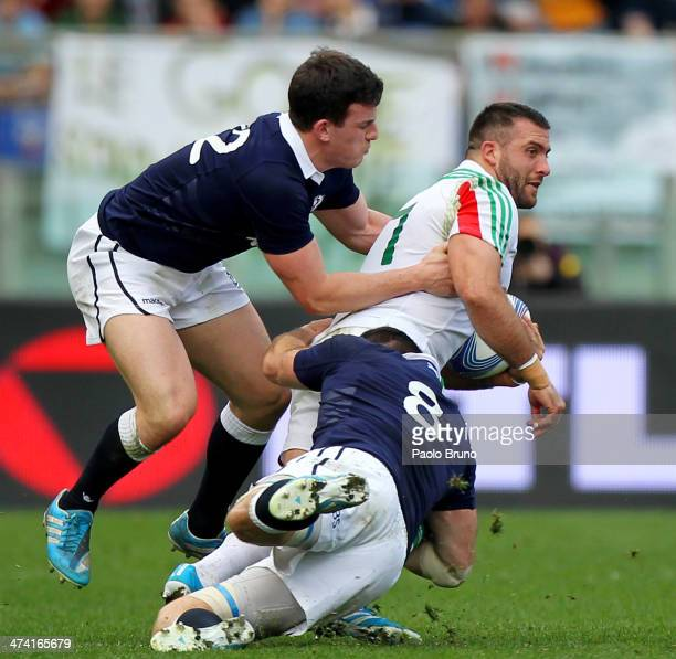 Robert Barbieri of Italy is tackled by Matt Scott and Johnnie Beattie of Scotland during the RBS Six Nations match between Italy and Scotland at...