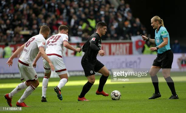 Robert Bauer of 1 FC Nuernberg Patrick Erras of 1 FC Nuernberg and Luka Jovic of Eintracht Frankfurt battle for the ball and referee Bibiana...