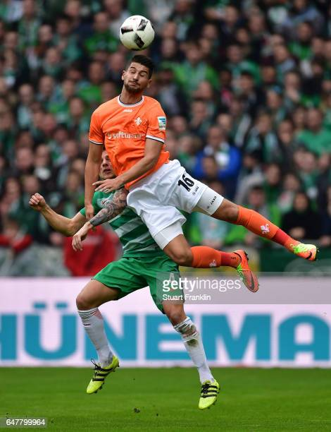 Robert Bauer of Bremen is challenged by Antonio-Mirko Colak of Darmstadt during the Bundesliga match between Werder Bremen and SV Darmstadt 98 at...