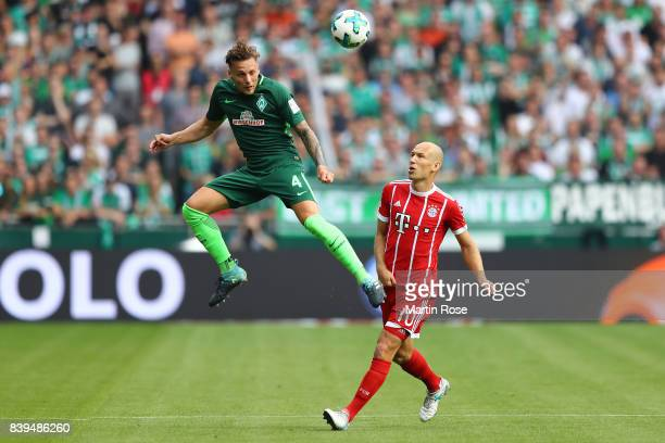 Robert Bauer of Bremen with Arjen Robben of Bayern Muenchen during the Bundesliga match between SV Werder Bremen and FC Bayern Muenchen at...