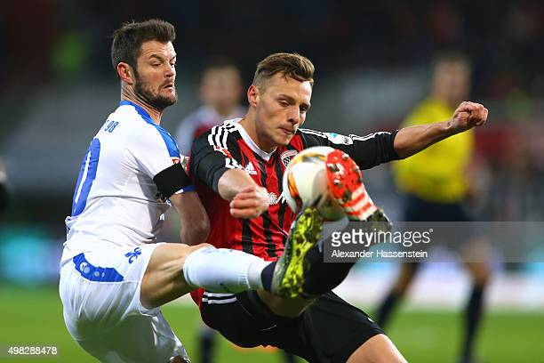 Robert Bauer of Ingolstadt battles for the ball with Marcel Heller of Darmstadt during the Bundesliga match between FC Ingolstadt and SV Darmstadt 98...