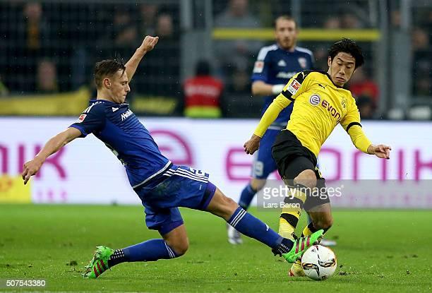 Robert Bauer of Ingolstadt challenges Shinji Kagawa of Dortmund during the Bundesliga match between Borussia Dortmund and FC Ingolstadt at Signal...