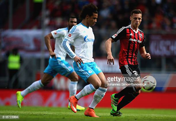 Robert Bauer of Ingolstadt fights for the ball with Leroy Sane of Schalke during the Bundesliga match between FC Ingolstadt and FC Schalke 04 at Audi...