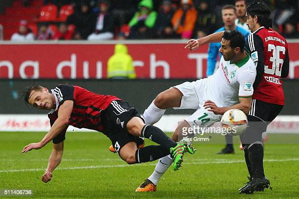 Robert Bauer of Ingolstadt is challenged by Claudio Pizarro of Bremen during the Bundesliga match between FC Ingolstadt and Werder Bremen at Audi...