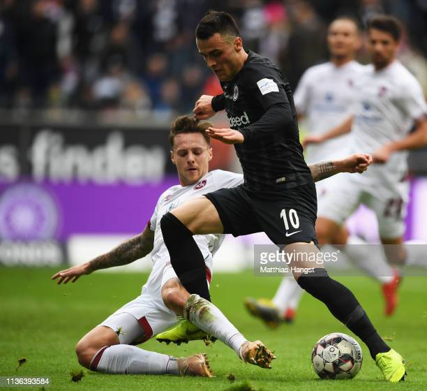 Robert Bauer of Nurnberg tackles Filip Kostic of Eintracht Frankfurt during the Bundesliga match between Eintracht Frankfurt and 1 FC Nuernberg at...