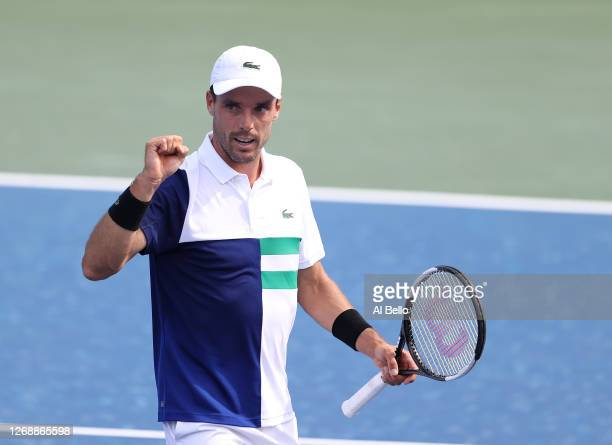 Robert Bautista Agut of Spain celebrates his three set win against Danill Medvedev of Russia during the Western & Southern Open at the USTA Billie...