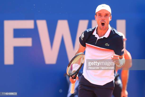 Robert Bautista Agut of Spain celebrates winning a point during his second round match against Rudolf Molleker of Germany on day 6 of the BMW Open at...