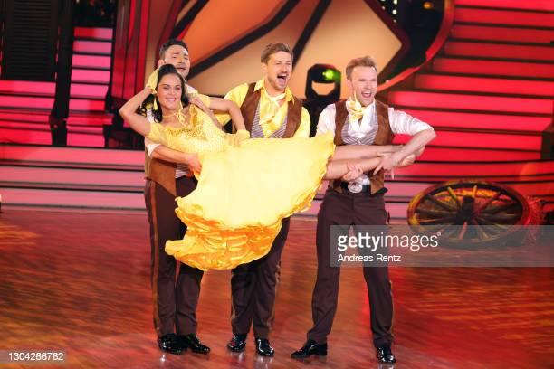 """Robert Beitsch, Nicolas Puschmann and Vadim Garbuzov hold Vanessa Neigert as they perform on stage during the pre-show """"Wer tanzt mit wem? Die grosse..."""