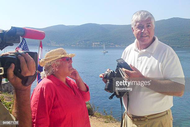 Robert Benmosche president and chief executive officer of American International Group right and his wife Denise speak during an interview at his...