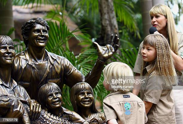 "Robert, Bindi and Terri Irwin view a statue of the family that was unveiled today during ""Steve Irwin Memorial Day"" at Australia Zoo on November 15,..."