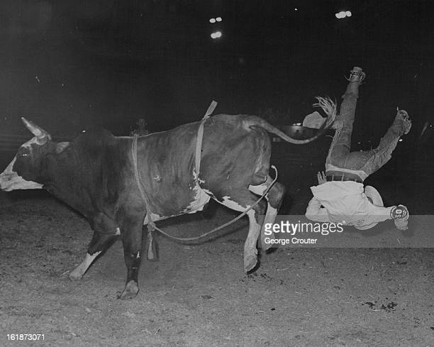 Robert Blackbird of Sam Houston is turned down after being thrown by Bomber in steer wrestling event. He placed fourth with time of :21.8. The leader...