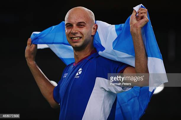 Robert Blair of Scotland celebrates after winning the Mixed Doubles Bronze Medal match with Imogen Bankier of Scotland against Peng Soon Chan and Lai...