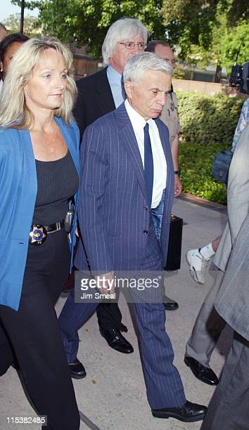 Robert Blake arrives escorted by Los Angeles County Sheriff's before a pretrial session on the murder charges he faces in the death of his wife Bonny...