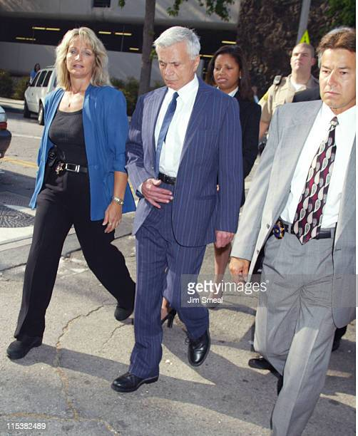 Robert Blake arrives escorted by Los Angeles County Sheriff's before a pre-trial session on the murder charges he faces in the death of his wife...