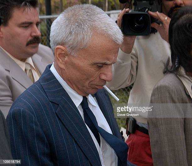 Robert Blake escorted by security personnel and members of his defense team departs the Van Nuys Superior Court after his arraignment in the murder...