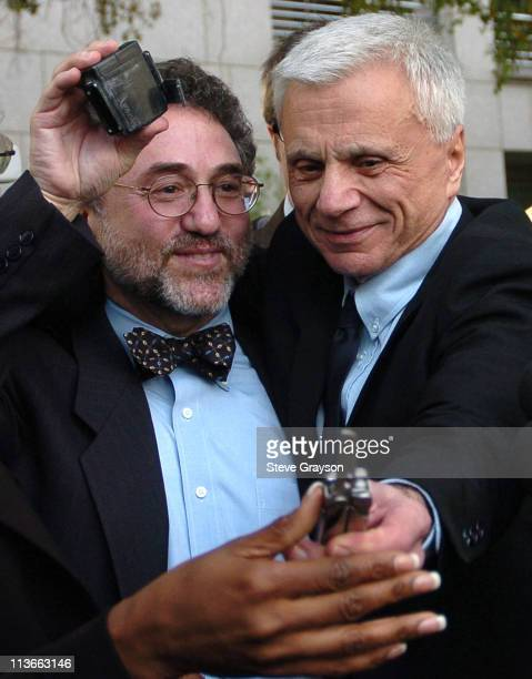Robert Blake hands back a pair of shears he used to cut off his electronic monitoring device held by his attorney M Gerald Schwartzbach after he was...
