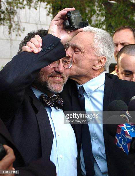 Robert Blake kisses his attorney M Gerald Schwartzbach who holds the electronic monitoring device that Blake wore during his house arrest Robert...
