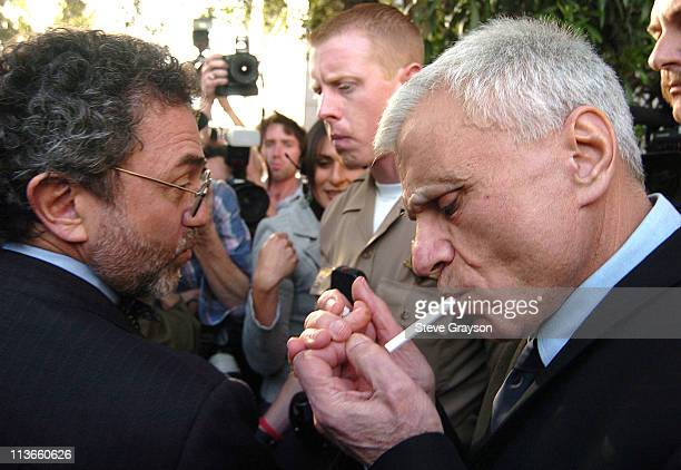 Robert Blake lights a cigarette outside the courthouse with attorney M Gerald Schwartzbach at the Van Nuys County Courthouse where Blake was...