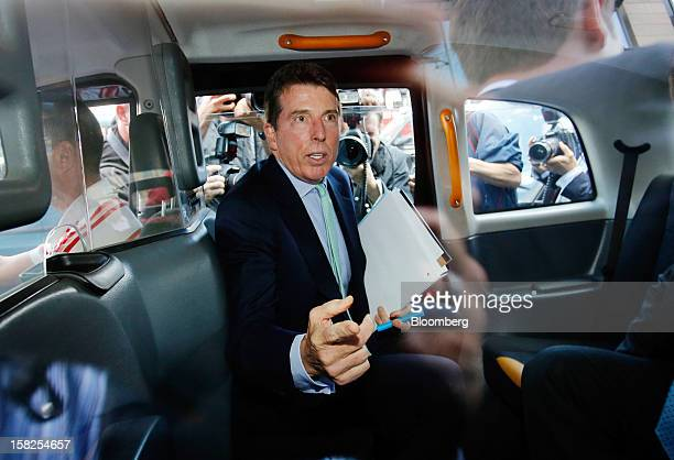 'BEST PHOTOS OF 2012' Robert 'Bob' Diamond former chief executive officer of Barclays Plc center reacts as he leaves Portcullis House in London UK on...