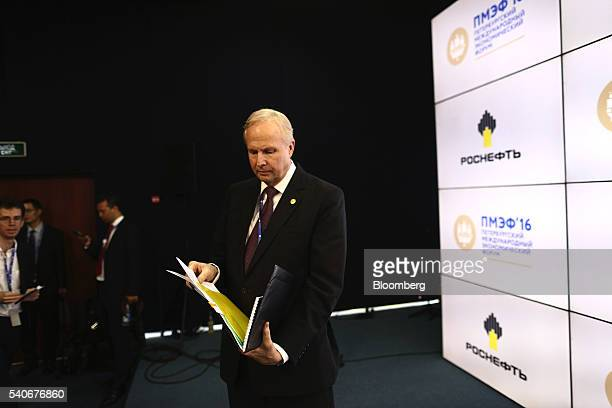 Robert 'Bob' Dudley chief executive officer of BP Plc arranges his notes on the opening day of the St Petersburg International Economic Forum 2016 in...