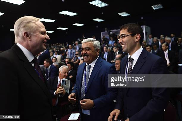 Robert 'Bob' Dudley chief executive officer of BP Plc left speaks to Rovnag Abdullayev chief executive officer of State Oil Co of Azerbaijan center...