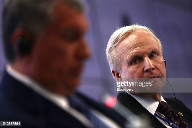 Robert 'Bob' Dudley chief executive officer of BP Plc right looks towards Igor Sechin chief executive officer of OAO Rosneft during a panel session...