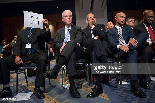 Robert 'Bob' Flanagan former DC Mayors Anthony Williams and Adrian Fenty watch the inauguration of DC Mayor Muriel Bowser and councilmembers in...
