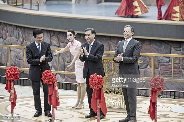 Robert 'Bob' Iger chief executive officer of Walt Disney Co right Wang Yang China's vice premier center and Han Zheng communist party secretary of...