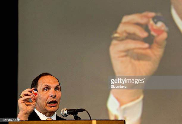 Robert 'Bob' McDonald chairman president and chief executive officer of Procter Gamble Co holds a Tide Pod while speaking at a luncheon sponsored by...