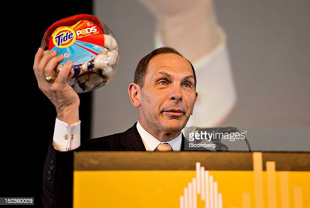 Robert 'Bob' McDonald chairman president and chief executive officer of Procter Gamble Co holds a package of Tide Pods while speaking at a luncheon...