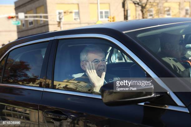 Robert 'Bob' Menendez drives away in his car as he departs federal court November 15 2017 in Newark New Jersey The jury continues to deliberate in...