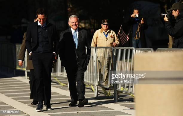 Robert 'Bob' Menendez walks to his car with his son Robert Jr as he departs federal court November 15 2017 in Newark New Jersey The jury continues to...