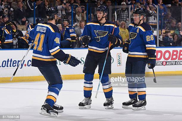 Robert Bortuzzo Carl Gunnarsson and Paul Stastny of the St Louis Blues celebrates after scoring a goal against the Vancouver Canucks at the Scottrade...