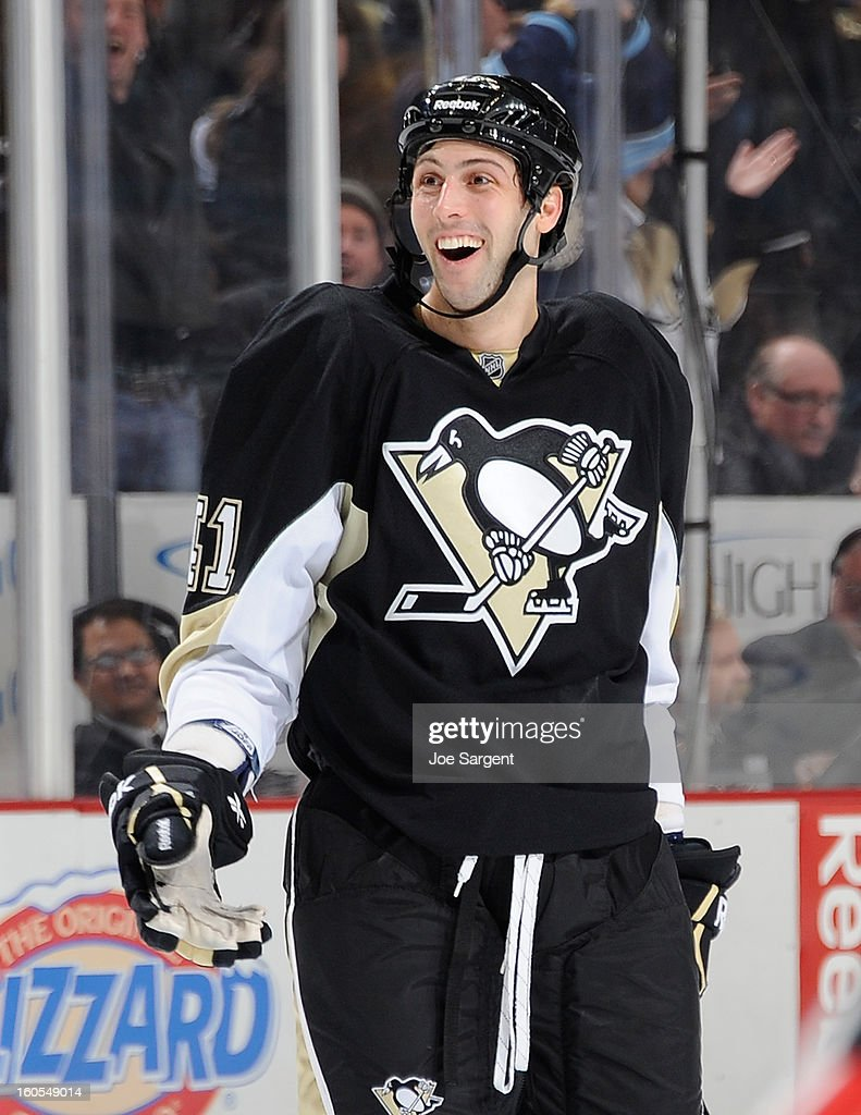 Robert Bortuzzo #41 of the Pittsburgh Penguins celebrates his first NHL goal during the game against the New Jersey Devils on February 2, 2013 at Consol Energy Center in Pittsburgh, Pennsylvania. Pittsburgh won the game 5-1.