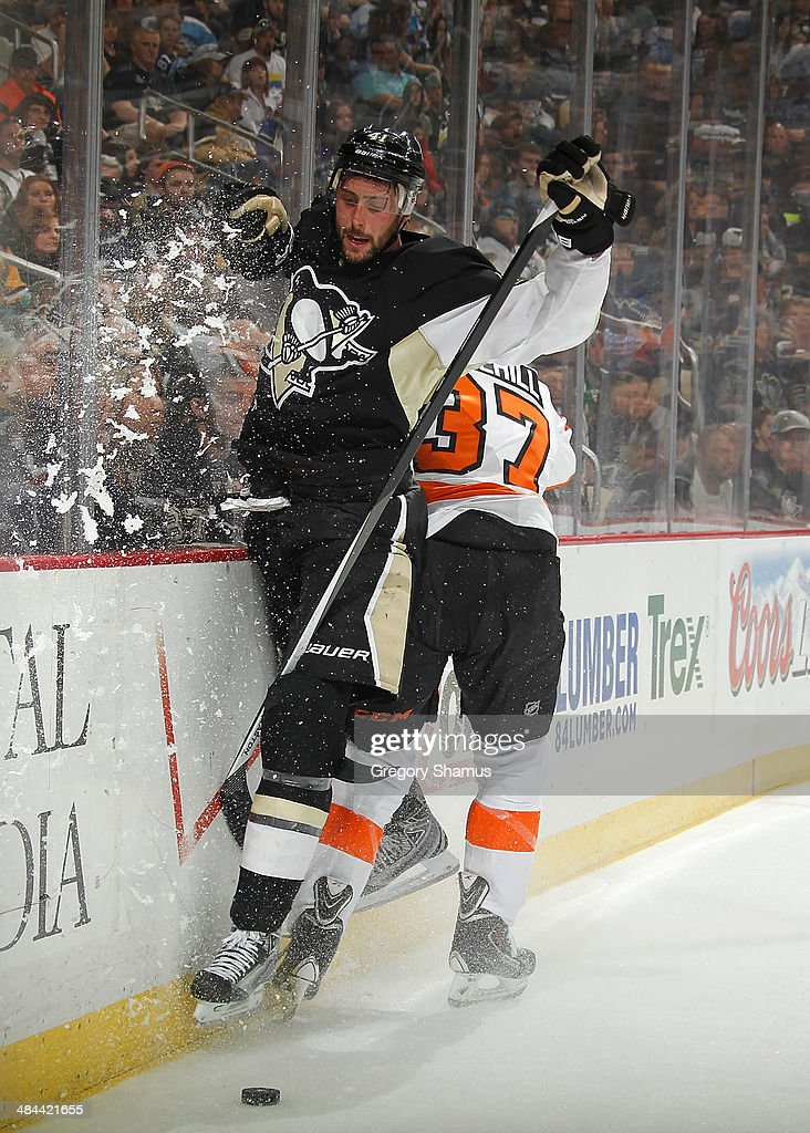 Robert Bortuzzo #41 of the Pittsburgh Penguins collides with Jay Rosehill #37 of the Philadelphia Flyers on April 12, 2014 at Consol Energy Center in Pittsburgh, Pennsylvania.