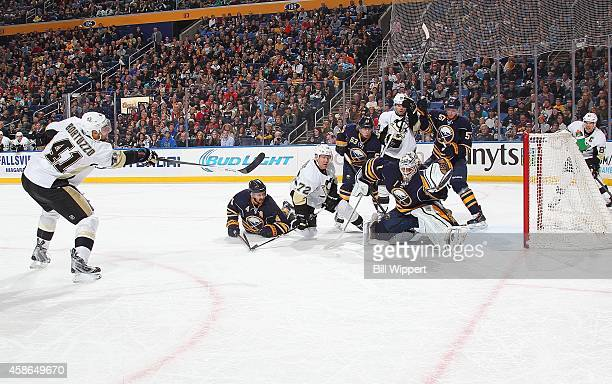 Robert Bortuzzo of the Pittsburgh Penguins scores a second period goal against Jhonas Enroth of the Buffalo Sabres on November 8 2014 at the First...