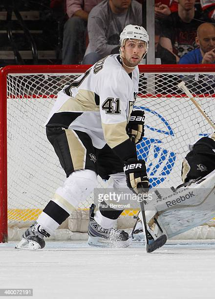 Robert Bortuzzo of the Pittsburgh Penguins skates during an NHL hockey game against the New Jersey Devils at Prudential Center on December 31 2013 in...