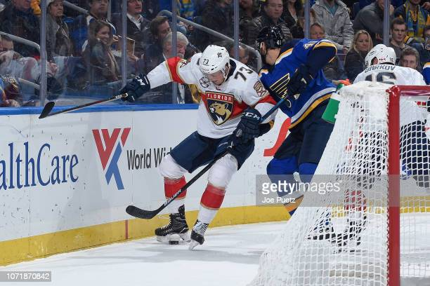 Robert Bortuzzo of the St Louis Blues and Dryden Hunt of the Florida Panthers battle for the puck at Enterprise Center on December 11 2018 in St...