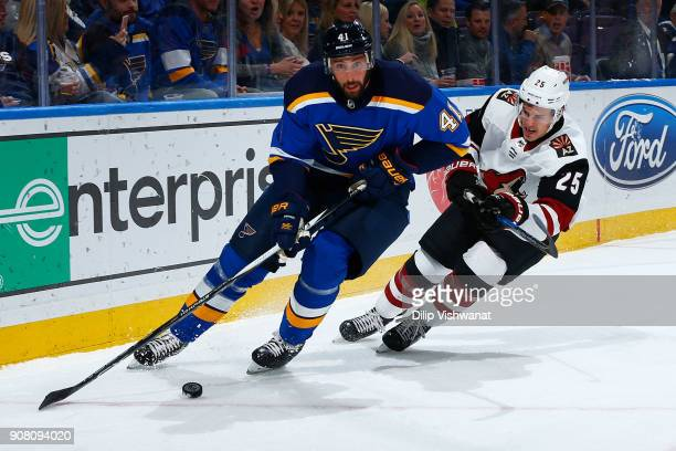 Robert Bortuzzo of the St Louis Blues controls the puck against Nick Cousins of the Arizona Coyotes at Scottrade Center on January 20 2018 in St...