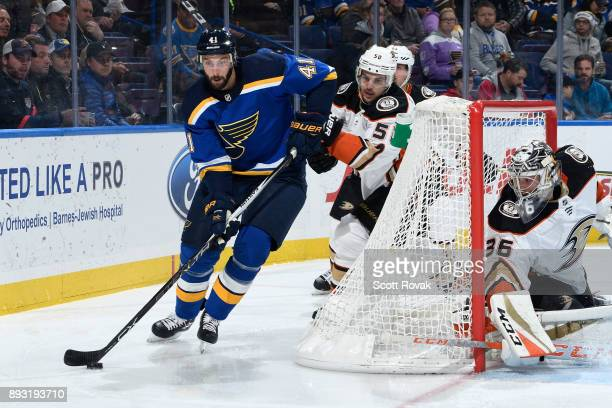 Robert Bortuzzo of the St Louis Blues controls the puck as Antoine Vermette of the Anaheim Ducks defends at Scottrade Center on December 14 2017 in...