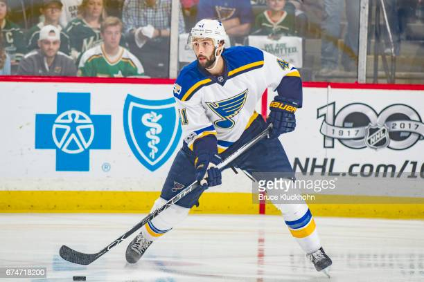 Robert Bortuzzo of the St Louis Blues handles the puck against the Minnesota Wild in Game Five of the Western Conference First Round during the 2017...