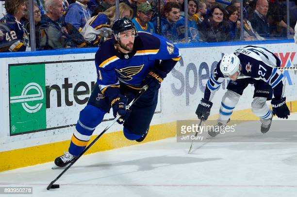 Robert Bortuzzo of the St Louis Blues handles the puck against the Winnipeg Jets at Scottrade Center on December 16 2017 in St Louis Missouri