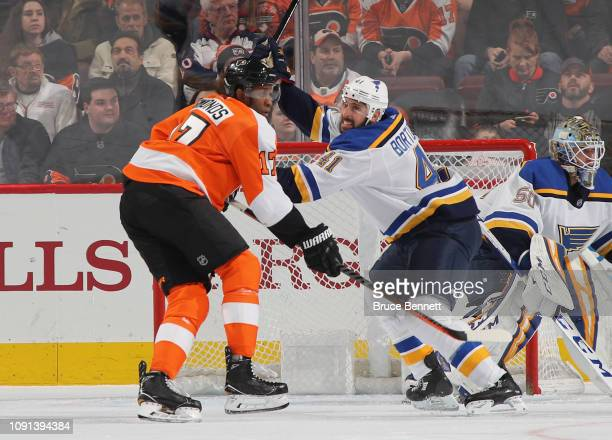 Robert Bortuzzo of the St Louis Blues holds up Wayne Simmonds of the Philadelphia Flyers at the Wells Fargo Center on January 07 2019 in Philadelphia...