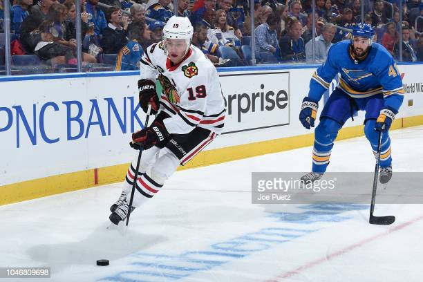 Robert Bortuzzo of the St Louis Blues pressures Jonathan Toews of the Chicago Blackhawks at Enterprise Center on October 6 2018 in St Louis Missouri