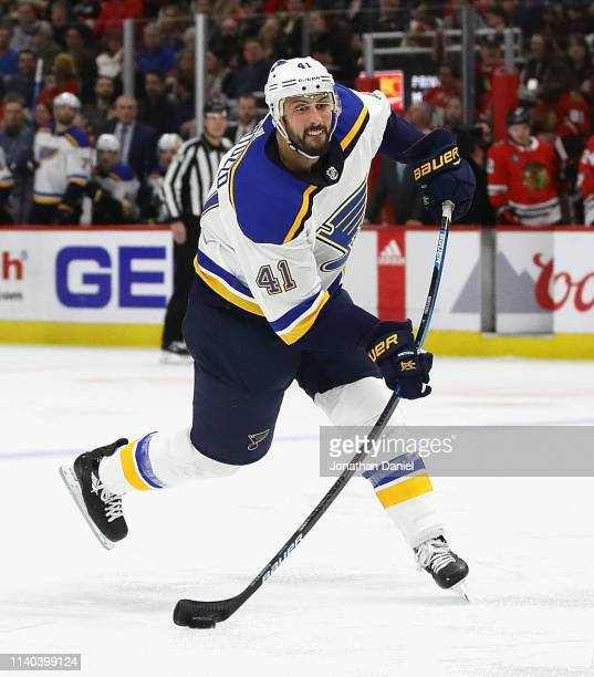 Robert Bortuzzo of the St Louis Blues shoots against the Chicago Blackhawks at the United Center on April 03 2019 in Chicago Illinois The Blackhawks...