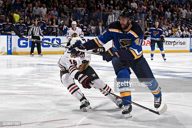 Robert Bortuzzo of the St Louis Blues shoots as Artem Anisimov of the Chicago Blackhawks defends in Game Five of the Western Conference First Round...