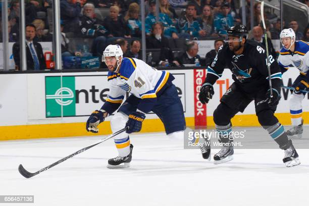 Robert Bortuzzo of the St Louis Blues skates against Joel Ward of the San Jose Sharks at SAP Center on March 16 2017 in San Jose California