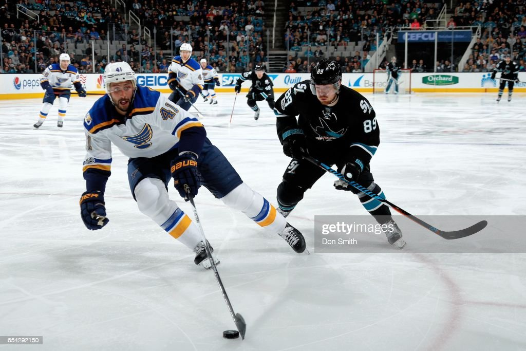 Robert Bortuzzo #41 of the St. Louis Blues skates against Mikkel Boedker #89 of the San Jose Sharks at SAP Center at San Jose on March 16, 2017 in San Jose, California.