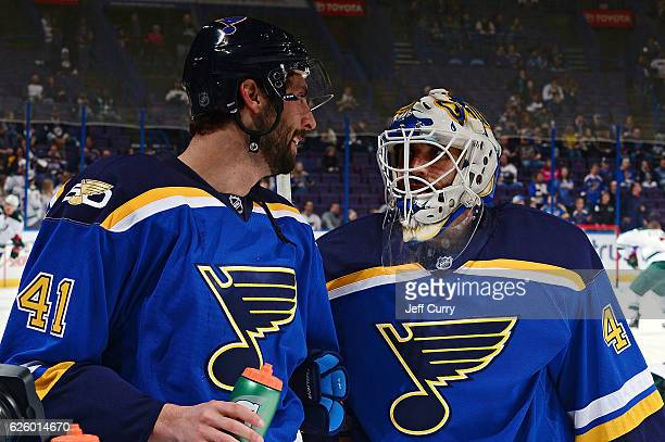 Robert Bortuzzo of the St Louis Blues talks with Carter Hutton prior to a game against the Minnesota Wild on November 26 2016 at Scottrade Center in...