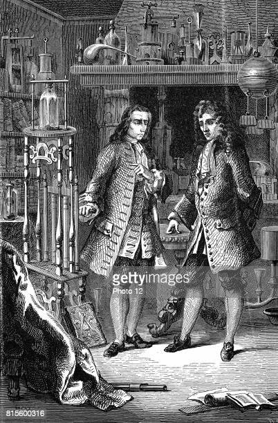 Robert Boyle AngloIrish chemist and physicist in his laboratory with Denis Papin French physicist Papin is pointing to Boyle's air pump Probably...